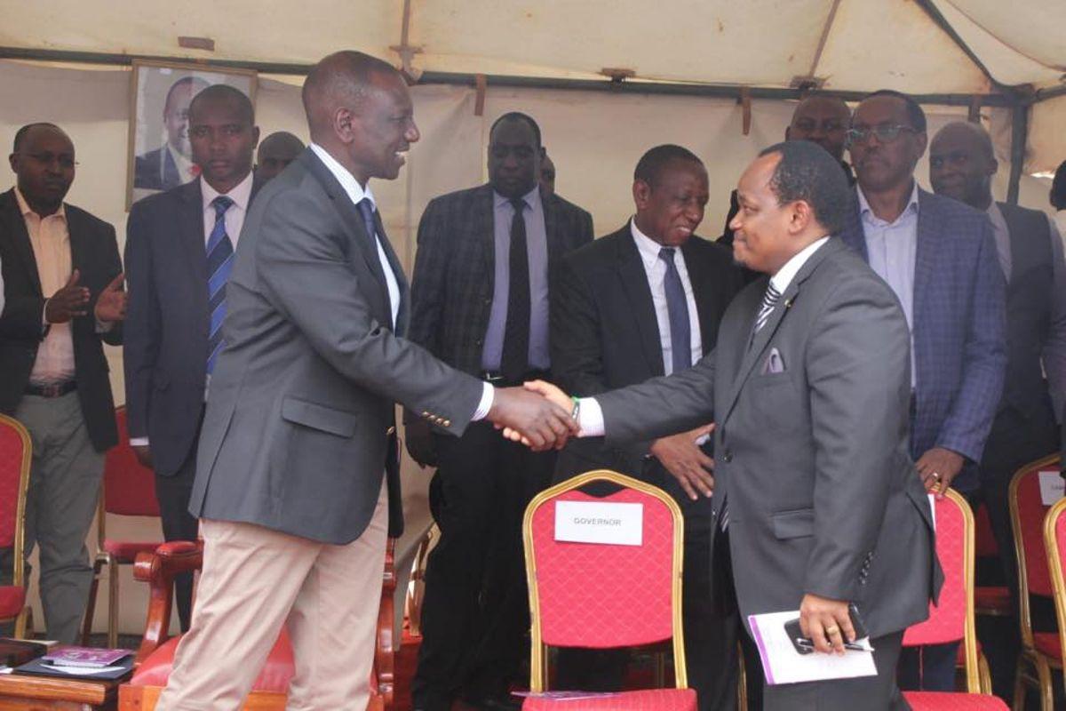 Ngunjiri Wambugu greeting William Ruto